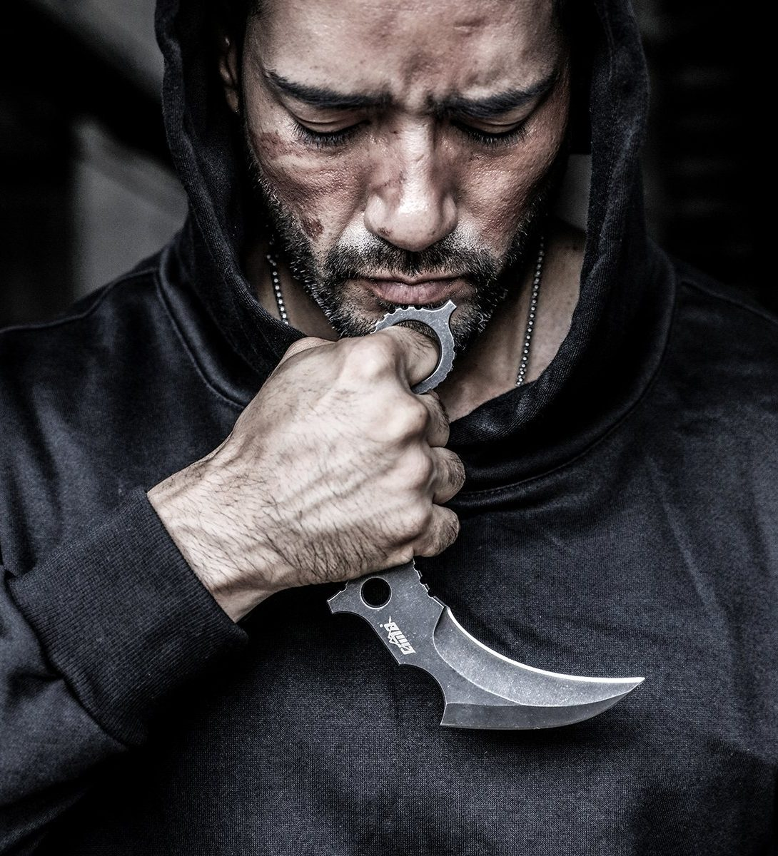 Man Holding Self-Defense Knife
